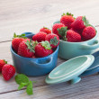 Bowls with strawberry on a table — Stock Photo