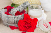 Spa settings with fresh red roses — Stock Photo
