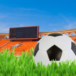 Soccer ball in grass on stadium — Stock Photo