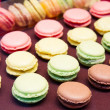 Rows of assorted macaroons — Stock Photo