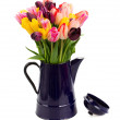 Blue pot with  of tulips flowers  close up — Stock Photo