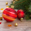 Red and orange ball on green fir tree — Stock Photo #36623653