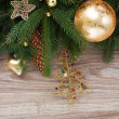 Golden decorations with green fir tree — Stock Photo