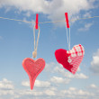 Two hanging red  hearts — Stock Photo