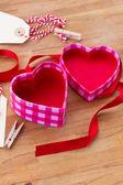 Open empty box in heart shape — Stock Photo