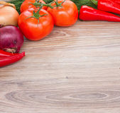 Wooden board with fresh vegetables — Stock Photo