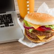 Eating at work place near laptop — Stock Photo #36991873