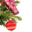 Christmas red and orange ballhanging on fir tree — Stock Photo