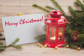 Merry christmas card with red glowing lantern — Stock Photo