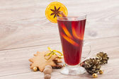 Mulled red wine on wooden table — Stock Photo