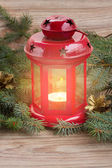 Lantern with glowing candle and fir tree — Stock Photo