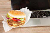 Lunch at work place near laptop — Stock Photo