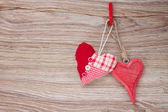 Two red hanging hearts — ストック写真