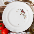 Stock Photo: Empty plate with tomatoes and olive oil