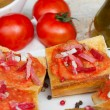 Stock Photo: Spanish tapas - bread with tomatoes and jamon