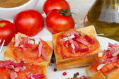 Spanish tapas - bread with tomatoes and jamon — Stock Photo