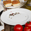 Stock Photo: Empty plate with tomatoes