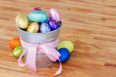 Easter eggs in metal pot on table — Stock Photo