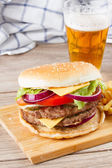 Big burger with beer — Stock Photo