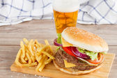 Burger with french fries and beer — Stock Photo