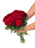 Hands holding bouquet of roses — Stock Photo
