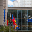 European flags and Europen parlament, Brussels — Stock Photo