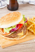 Big hamburger with beer — Stock Photo