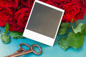 Fresh red roses with instant photos — Photo