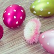 Easter eggs with daisy flowers — Stock Photo