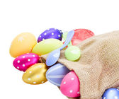 Pile of colorful easter eggs in pouch — Stock Photo