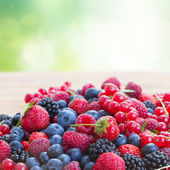 Ripe  of  berries on table — Stock Photo
