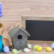 Easter decoration with eggs and blank board — Stock Photo