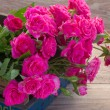 Pink roses on wooden table — Stock Photo