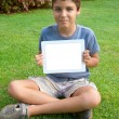 Boy showing empty tablet PC — Stock Photo