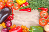 Blank wooden table  with colorful vegetables — Stock Photo