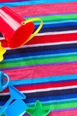 Plaża zabawek na ręcznik — Zdjęcie stockowe