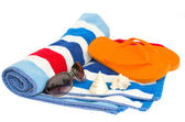 Beach striped  towel and sandals — Stock Photo