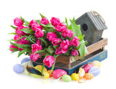 Bunch of pink tulips and easter eggs — Stock Photo