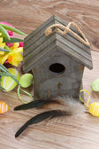 Birdcage with easter eggs — Stock Photo