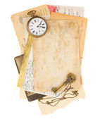 Pile of old photos and papers with antique clock — Stock Photo