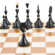 Black knight in front of black chess — Stock Photo