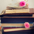 Pile of old books and mail with cup of tea — Stock Photo #44370793