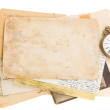 Bunch of old photos and papers with antique clock — Stock Photo