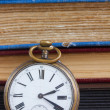 Antique clock on books background — Stock Photo #45009923