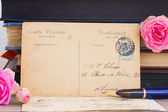 Antique empty postcard with flowers and quill pen — Foto de Stock