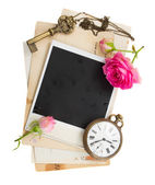 Pile of old photos  with antique clock, key and roses — ストック写真
