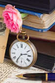 Antique clock on old  books and letters background — Stock Photo