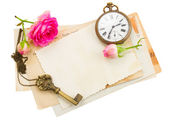 Bunch of old papers with roses — Stock Photo