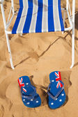 Beach chair with sandals — Stock Photo