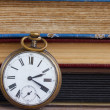 Antique clock on books background — Stock Photo